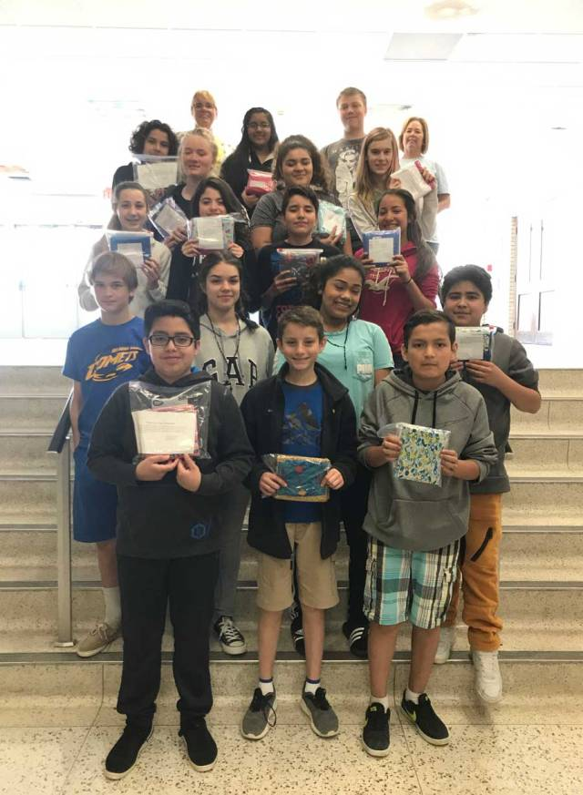 IMAGE: Phoenix Seventh graders with their pillow cases for Ryan's Case for Smiles