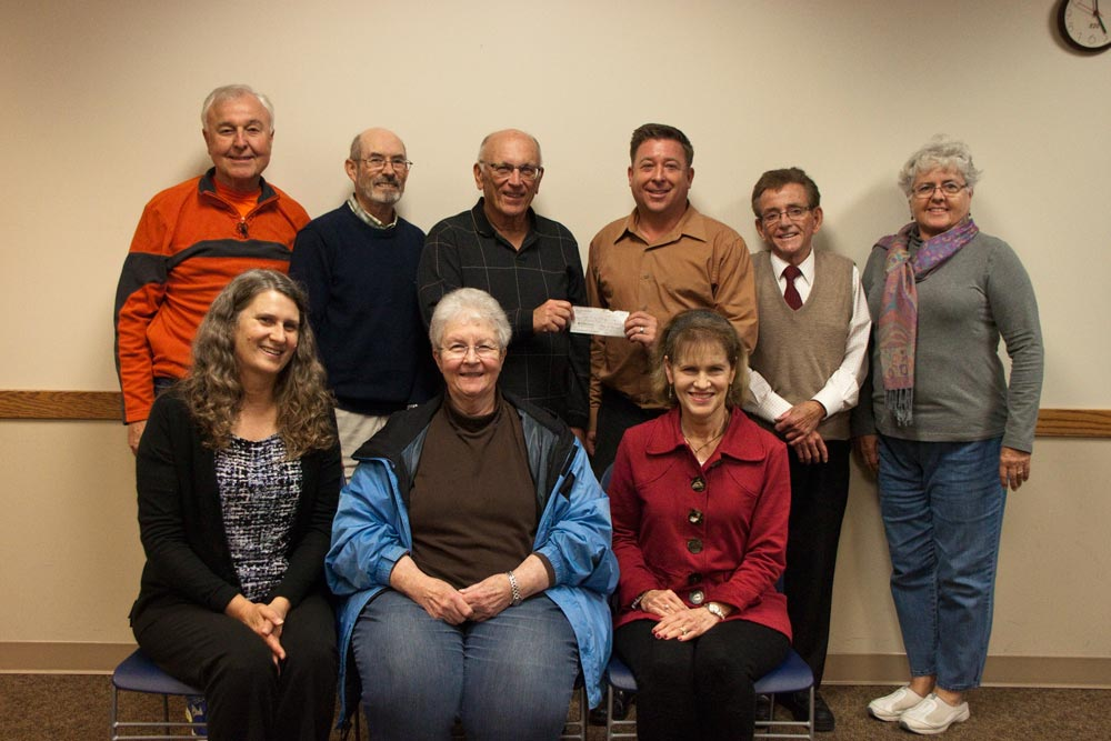 IMAGE: A check presentation by Lions Club President to the Aram Public Library Foundation