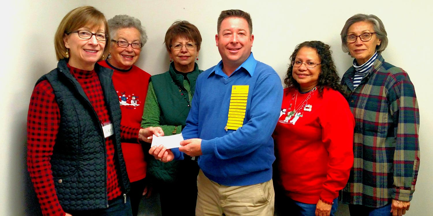 IMAGE: HELPING OUR FOOD PANTRY: Delavan Lions Club President Ryan Schroeder presented a check to the Delavan Food Pantry for 1,200 dollars on behalf of the club. Pictured with Schroeder are volunteers from the Delavan Food Pantry. From left to right are Terry Bailey, Jean Getka, Eva Godina, Elma Morales, and Dela Reece.